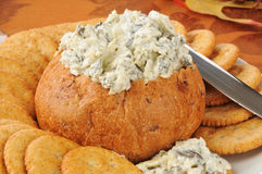 Spinach artichoke dip in a bread bowl Royalty Free Stock Photo