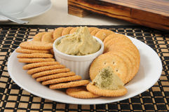Hummus on crackers Stock Photo