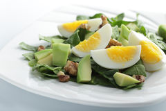Spinach, avocado, and eggs salad Royalty Free Stock Images