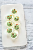Spinach and bacon deviled eggs. On the white plate Royalty Free Stock Photography