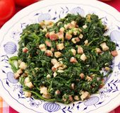 Spinach with bacon and garlic Stock Images