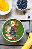 Green smoothie bowl royalty free stock photo