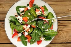 Spinach and blood oranges salad with cottage cheese and peanuts Stock Photos