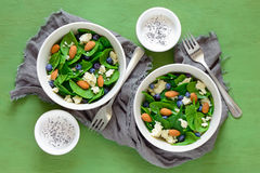 Spinach and blueberry salad bowls Stock Photography