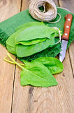 Spinach on board with knife and napkin Royalty Free Stock Image