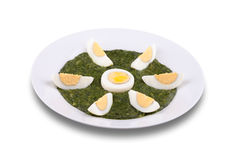 Spinach with boiled egg Stock Photos