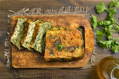Spinach bread on a cutting board. Top view stock images