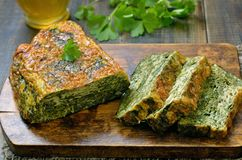 Spinach bread on wooden board. Close up Royalty Free Stock Image