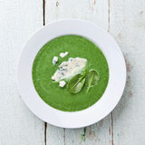 Spinach broccoli soup with cheese stock photography