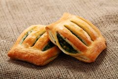 Spinach buns on a natural tablecloth Stock Photo