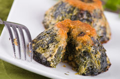 Spinach cakes on wooden cutting board. Stock Photography