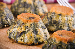 Spinach cakes on wooden cutting board. Stock Images