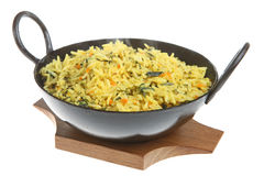 Spinach and Carrot Pilau Rice. Indian spiced rice with spinach and carrot (with visible steam rising Stock Photo