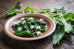 Spinach with cheese and olives Royalty Free Stock Photography
