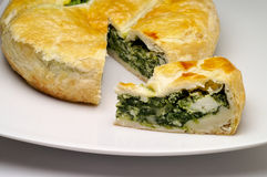 Spinach and cheese pie. In ceramic dish Stock Photos