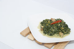 Spinach with coconut milk Royalty Free Stock Photo