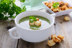Spinach cream soup with croutons Stock Photo