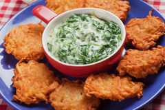 Spinach cream soup with potato pancakes stock images