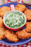 Spinach cream soup with potato pancakes Stock Image
