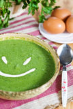 Spinach cream soup smile Stock Images