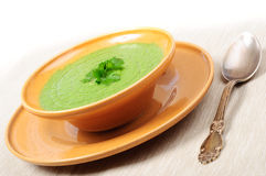 Spinach cream soup. Vegetable spinach cream soup on a table Stock Photo