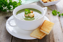 Spinach cream soup  in white bowl Stock Photo