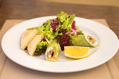 Spinach crepes with salmon and salad mix Stock Photo