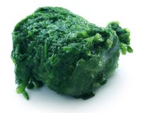 Spinach cube as frozen product royalty free stock photography