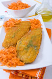Spinach cutlet on white dish. Stock Photos