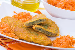Spinach cutlet on white dish. Royalty Free Stock Photography