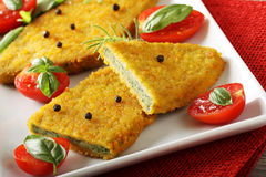 Spinach cutlets with tomato salad. On complex background Royalty Free Stock Photo