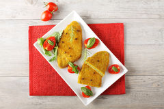 Spinach cutlets with tomato salad. On complex background Royalty Free Stock Images