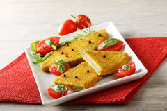 Spinach cutlets with tomato salad. On complex background Royalty Free Stock Image