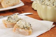 Spinach dip on Italian toast Stock Photos