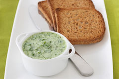 Spinach dip with toasts Stock Image
