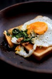 Spinach egg on toast Stock Photos