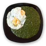 Spinach with eggs Stock Photos