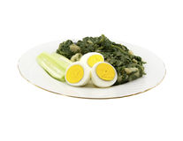 Spinach and eggs Royalty Free Stock Photo