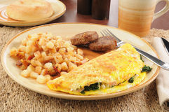 Spinach and feta cheese omelet with sausage Royalty Free Stock Image