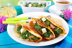 Spinach and feta filled pancakes Stock Photography