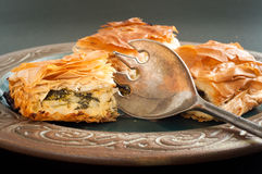 Spinach and feta pie. Home made spinach and feta pie. A popular Greek Cypriot dish made with layered filo pastry Stock Images