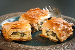 Spinach and feta pie. Home made spinach and feta pie. A popular Greek Cypriot dish made with layered filo pastry Stock Photography