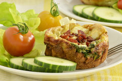 Spinach and Feta Quiche. Baked Spinach and Feta Quiche muffins with bacon bits Stock Photo