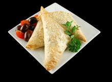 Spinach And Feta Triangles. Spinach and feta cheese triangles with olives and cherry tomatoes Royalty Free Stock Images