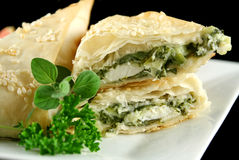 Spinach And Feta Triangles. Spinach and feta cheese triangles with garnish Stock Image