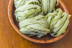 Spinach Fettuccine Nests Royalty Free Stock Images