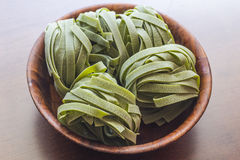 Spinach Fettuccine Nests Stock Photos