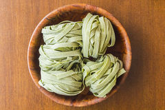 Spinach Fettuccine Nests Stock Images