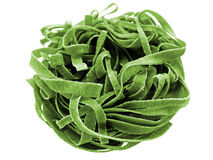 Spinach fettuccine pasta. Close-up of raw spinach fettuccine pasta Royalty Free Stock Image