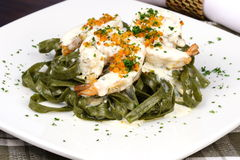 Spinach fettuccine with prawns Royalty Free Stock Photo